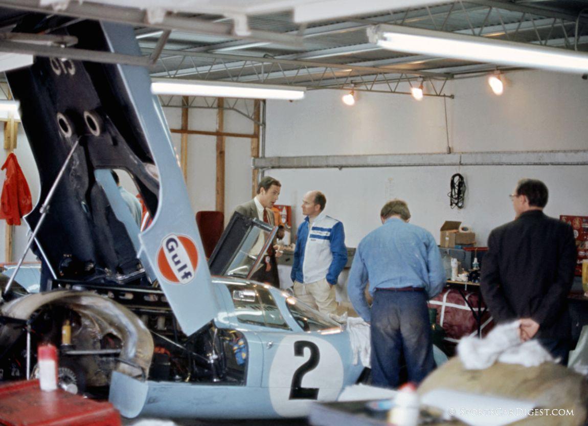 Rico Steineman and Tony Dean in the Gulf Porsche garages at Daytona. (Fred Lewis photo)