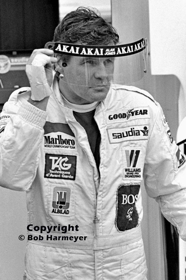 Alan Jones checks a replacement helmet visor before practice for the 1981 Canadian Grand Prix.