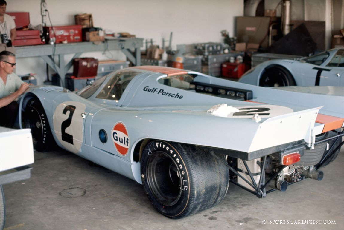 Putting the finishing cosmetic touches on what would be the winning Gulf Porsche 917K prior to the start of the race. (Fred Lewis photo)