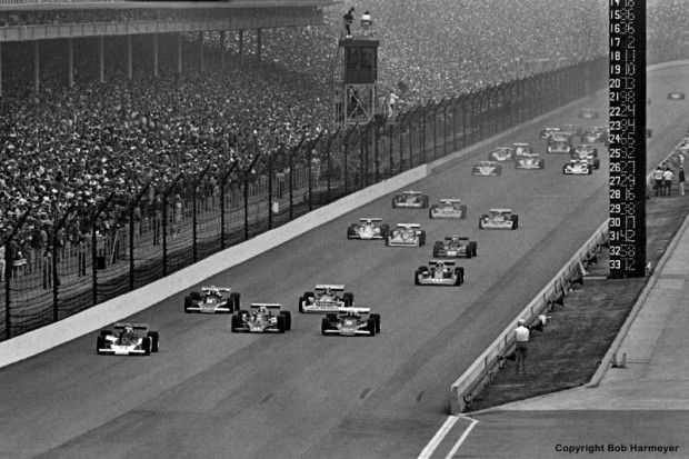 From the outside of the front row, Al Unser accelerates into the lead as the field takes the green flag and heads toward Turn 1 on the opening lap of the race.