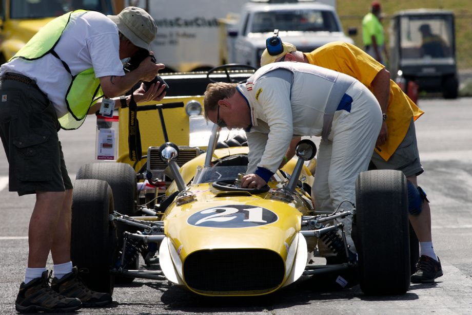 Michael McKinney owner and driver of the 1967 Rolla Volsted Ford engined indy car and his crew ready the car for it's first outing at PIR. The photographers were never far away from the car, it's driver, or it's crew.