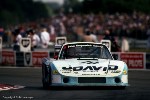 "John Fitzpatrick drives his Porsche 935/78-81 JR-002 en route to a fourth place finish with co-driver David Hobbs. This ""Moby Dick"" version was the final development of the 935 series and was designed specifically for Le Mans. In addition to the longer tail, the car featured right-hand drive for better vision around Le Mans' right turns like Tertre Rouge and the Mulsanne Corner."