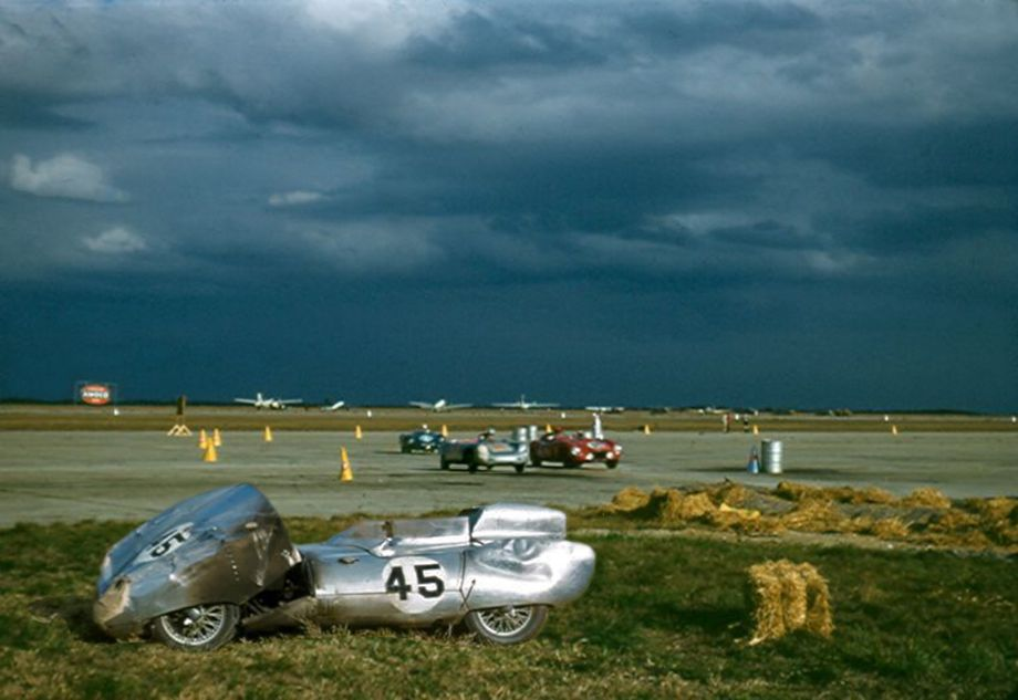 The Chapman-Bastrup Lotus Mk. XI waiting to be towed to Cunningham's hanger.  The car was not repairable and had to be withdrawn.  Chapman then got a ride co-driving Jo Sheppard's Lotus Mk. IX which was disqualified on lap 60 for an illegal start.