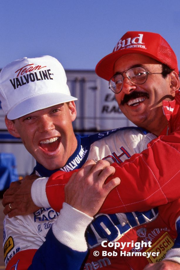Al Unser, Jr. (left) was ambushed with an unexpected bearhug from CART champion Bobby Rahal during a photo session before the 1988 season's opening event in Phoenix.