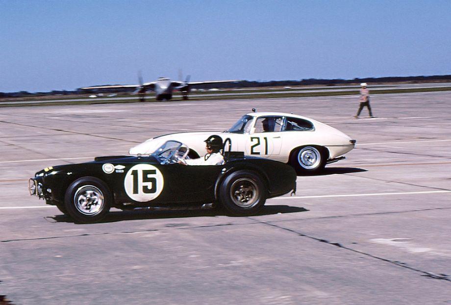 Dan Gurney in his Cobra and William Kimberly in his Briggs Cunningham prepared Jaguar E-type