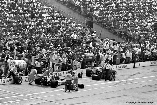 Al Unser (left) and Mario Andretti pit together during an early segment of the 1977 Indy 500.