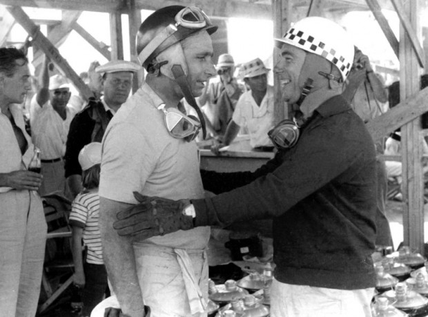 Juan Manuel Fangio and Jean Behra share a happy moment as Maserati team mates