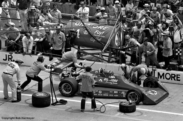 AJ Foyt makes an early-race stop for fuel in 1977. While the crew has fresh tires available, a close look reveals the rubber on the near side of the car was not changed on this stop.