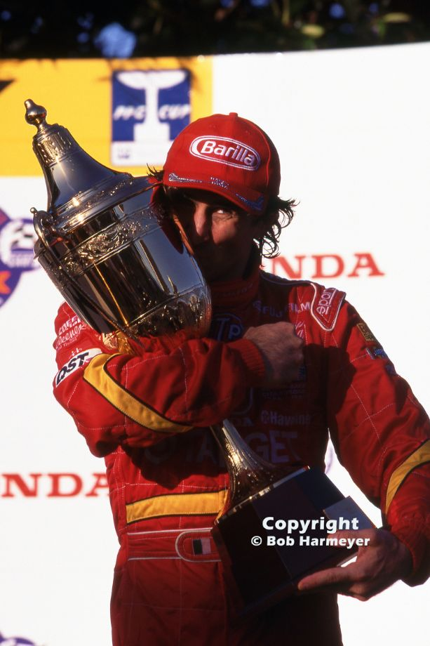 Alex Zanardi hugs the trophy after winning the 1998 CART race in Surfers Paradise, Australia, en route to his second consecutive championship for Chip Ganassi.