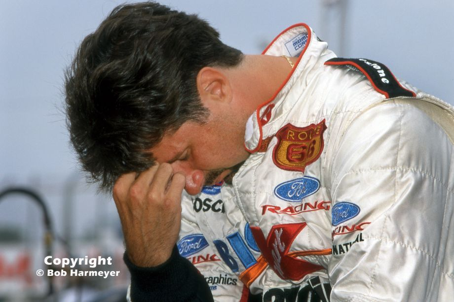 Michael Andretti spends a contemplative moment alone on the pit wall before qualifying for the 2000 CART race in Toronto. Andretti went on to win the event, his sixth victory on the streets around Exhibition Place.