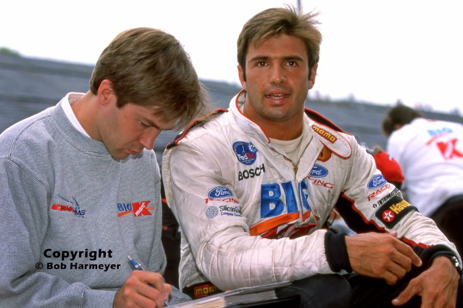 Christian Fittipaldi (right) speaks with Newman-Haas engineer Todd Bowland following practice for the 2000 CART race at Motegi, Japan.
