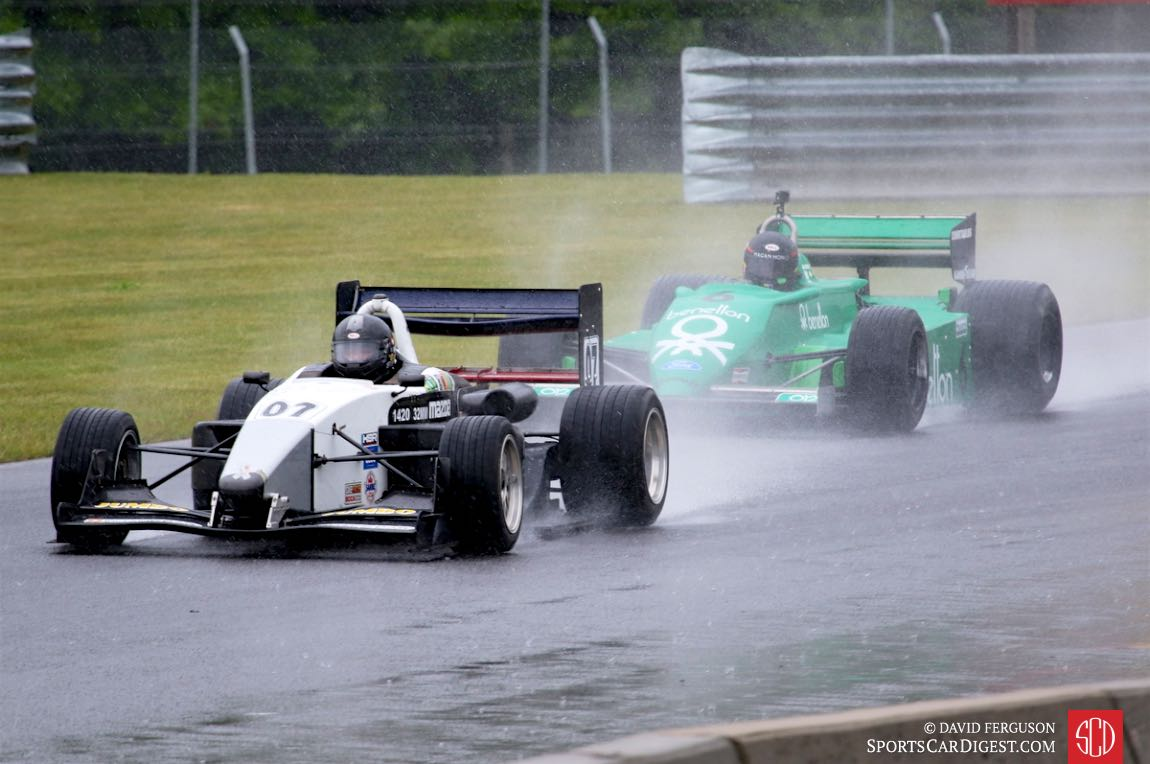 Jacek Mucha, 06 Swift 016, and James Hagan, 80 Tyrrell 011, in the rain.
