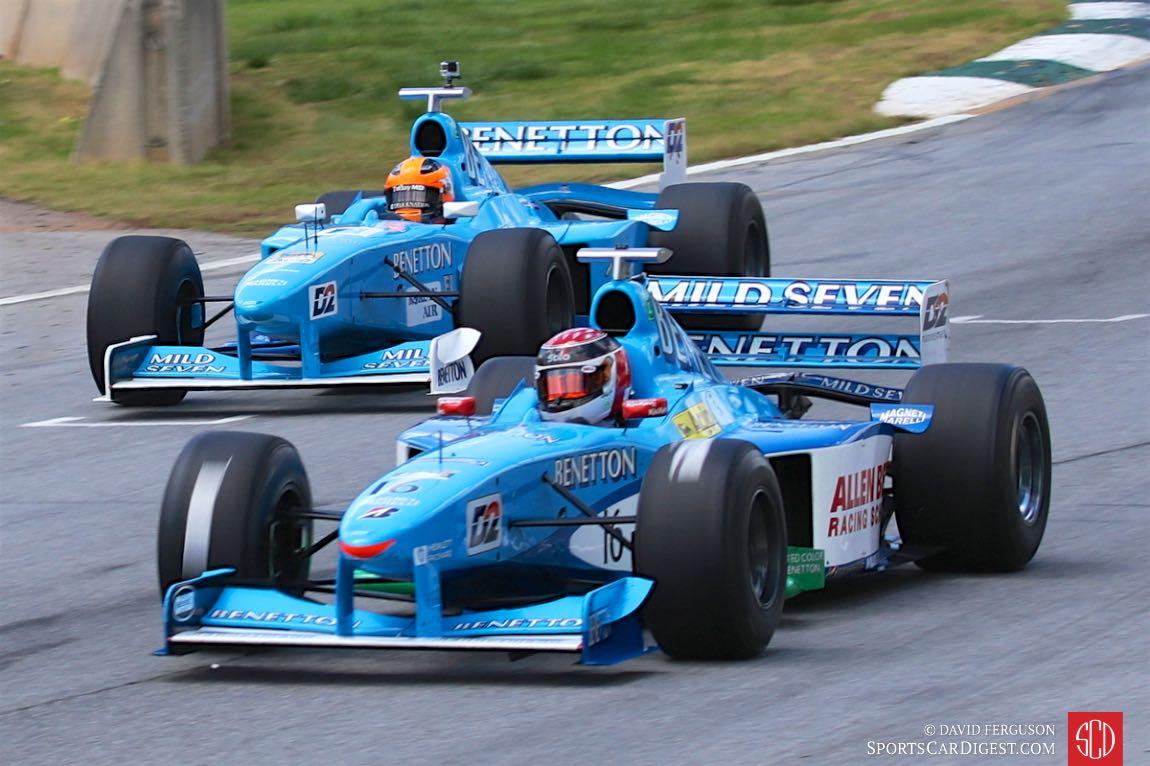 Phil Stratford, 98 Benetton B198, leads Roberto Garcia in similar car.