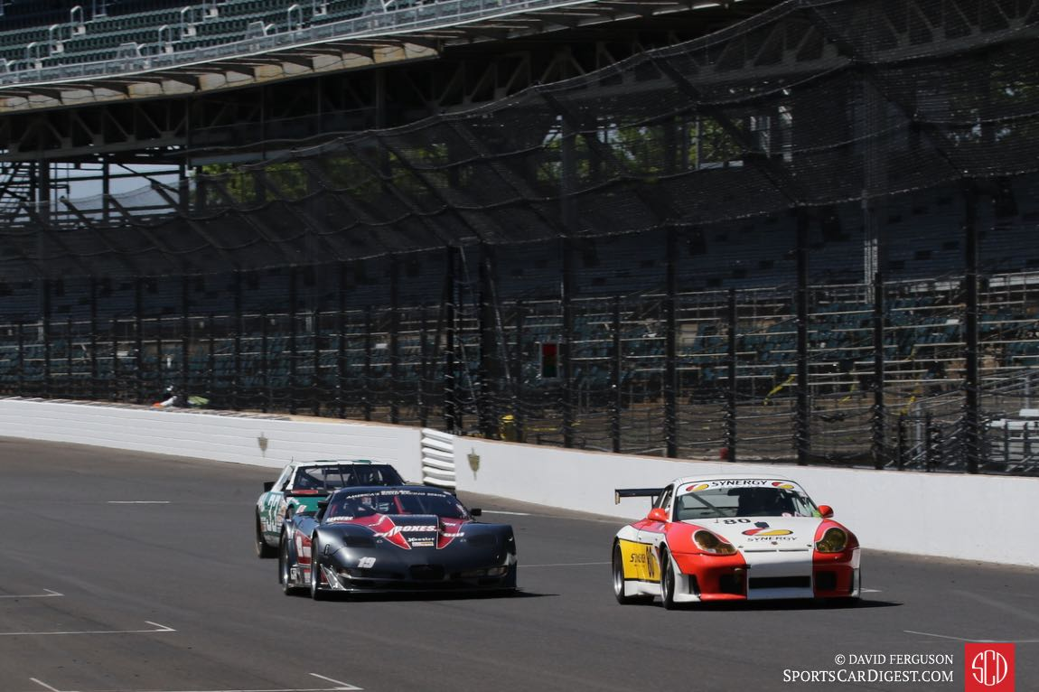 Danny Marshall, 01 Porsche GT3RS and Ricky Sanders, 04 Corvette lead Matt Parent's 88 Olds Cutlass Winston Cup car.