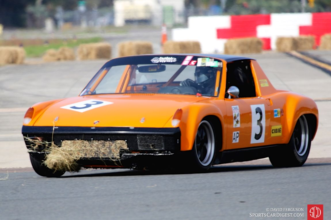 Jim Lenehan's 1972 Porsche 914/6 shows evidence of contact with a hay bale