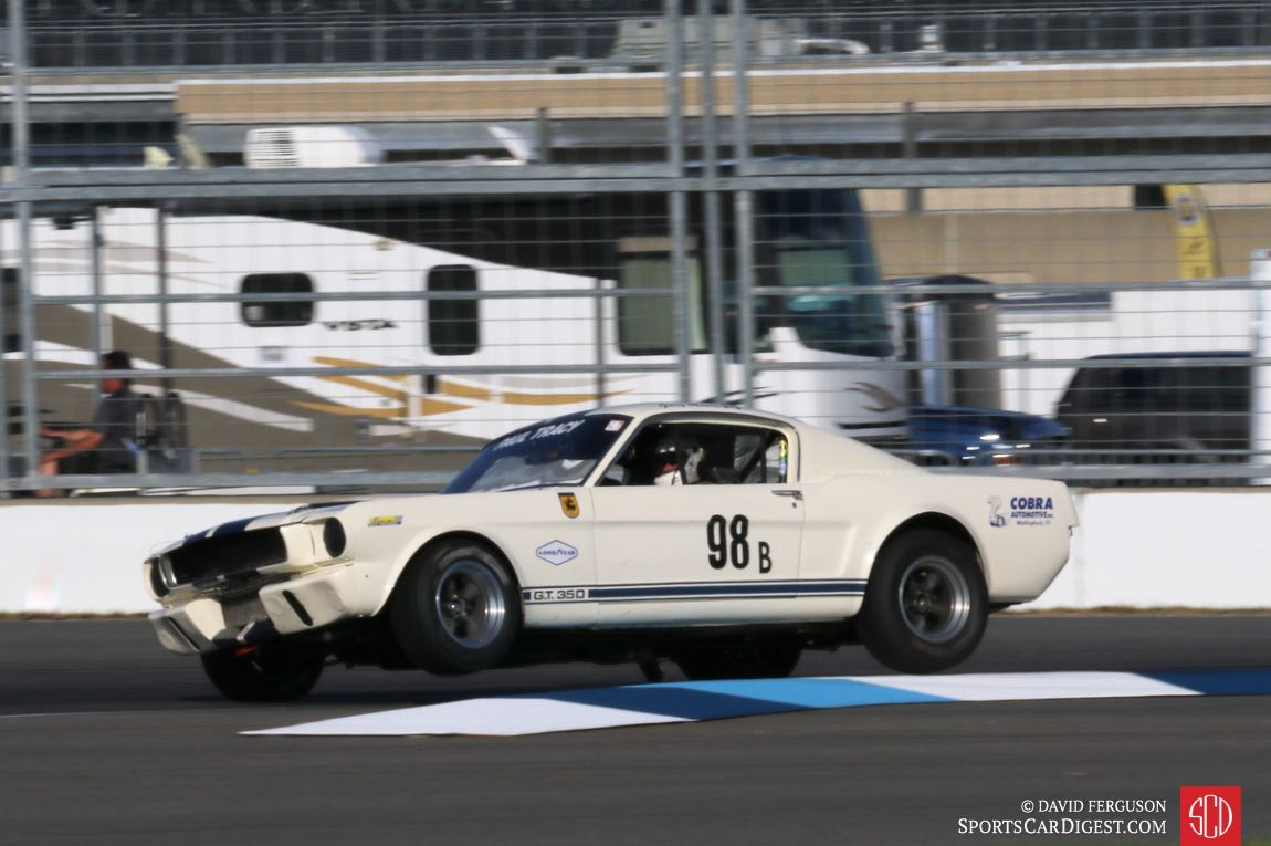 Gary Moore lifts two tires in his 65 Ford Mustang GT350