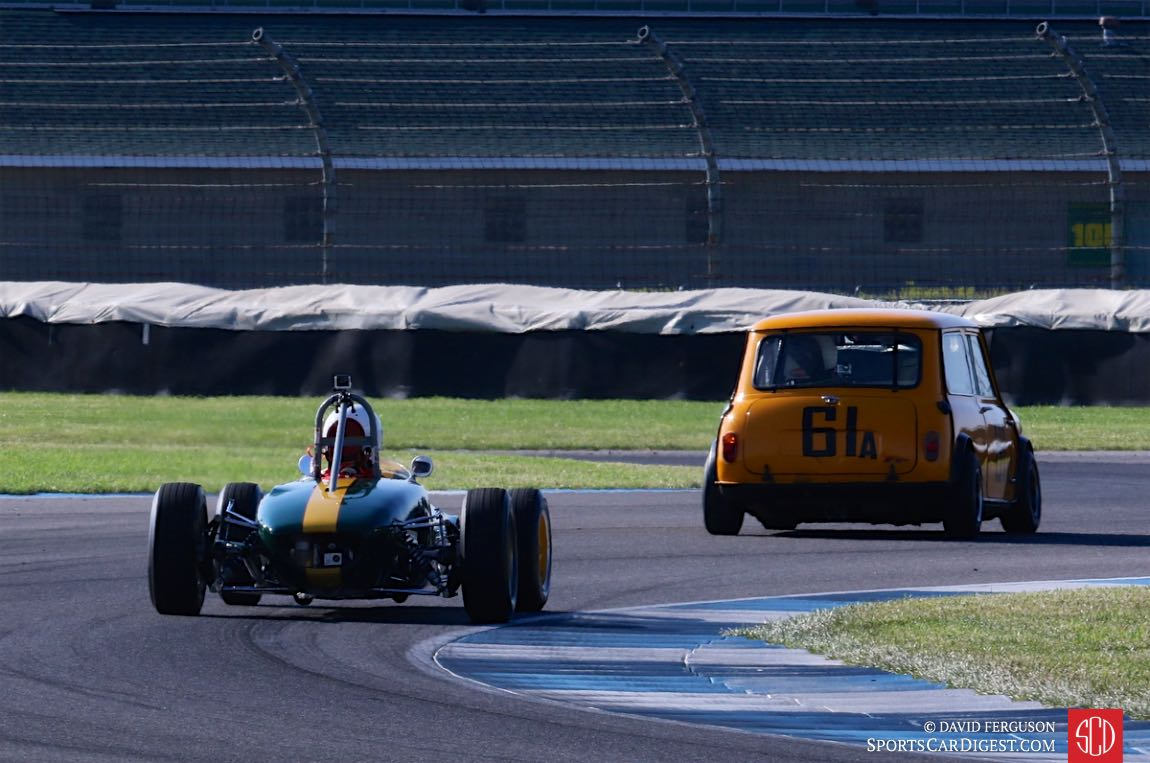 A Lotus 20 following a Mini Cooper through turn 8.