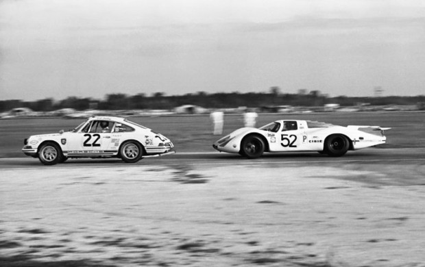 Vic Elford in a works Porsche 908 at Daytona in 1969 about to pass the Porsche 911 of Bob Bailey, Jim Locke and Mike Downs.  Mechanical ailments prevented the Porsche factory team  from repeating their 1968 1-2-3 finish at Daytona.  Elford's co-driver was Brian Redman.  Lou Galanos photo.