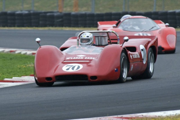 McLaren M6B of David Hankin leads Chevron B16 of Gray Gregory through turn 5 on a damp Sunday morning.