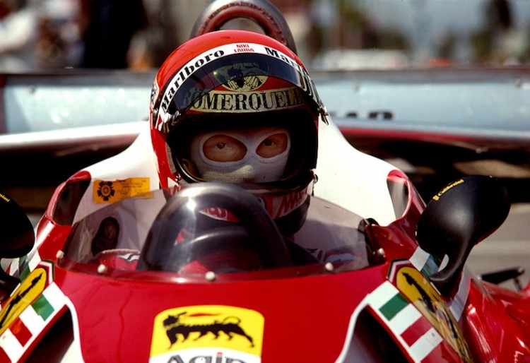 Niki Lauda's Ferrari 312 T2 sits in the pits just before the track opens for qualifying in the 1977 United States Grand Prix West at Long Beach. Lauda qualified first in front of Mario Andretti's Lotus and Jodi Scheckter's Wolf. He would finish 2nd to Andretti in the race.