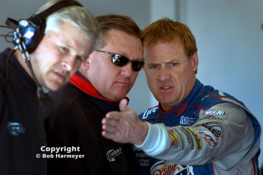 Rusty Wallace speaks with his crew in the garage area at Daytona during a NASCAR test session before the 2005 season.
