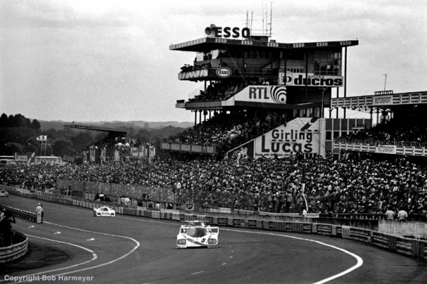 The Porsche CK5 01 of Bill Whittington, Danny Ongais and Ted Field  is driven past the iconic Le Mans grandstand and into the Dunlop Curve.