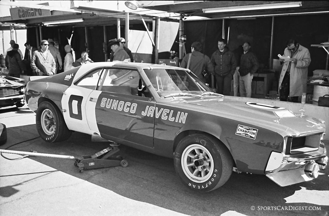 Mark Donohue, standing near car, drove this Sunoco Penske AMC Javelin but failed to finish. His co-driver was Peter Revson. (Lou Galanos photo)