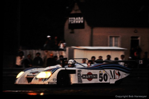 The Lancia Martini LC1 001003 driven by Hans Heyer, Riccardo Patrese and Piercarlo Ghinzani approaches the Ford Chicane during the early evening hours of the race.