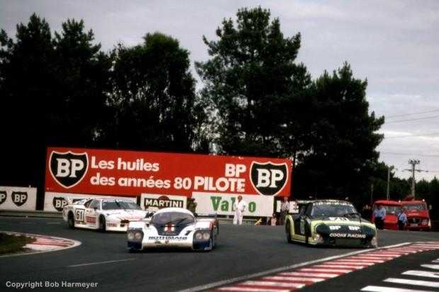 The winning Porsche 956 002 of Jacky Ickx and Derek Bell works through slower traffic in the Mulsanne Corner.