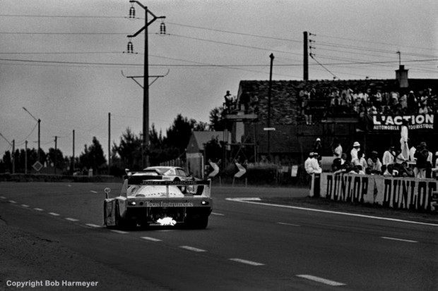Spitting fire from the turbo exhaust, the Joest Racing Porsche 936C JR005 driven by Bob Wollek, Jean-Michel Martin and Philippe Martin closes on slower traffic entering the Mulsanne Corner.