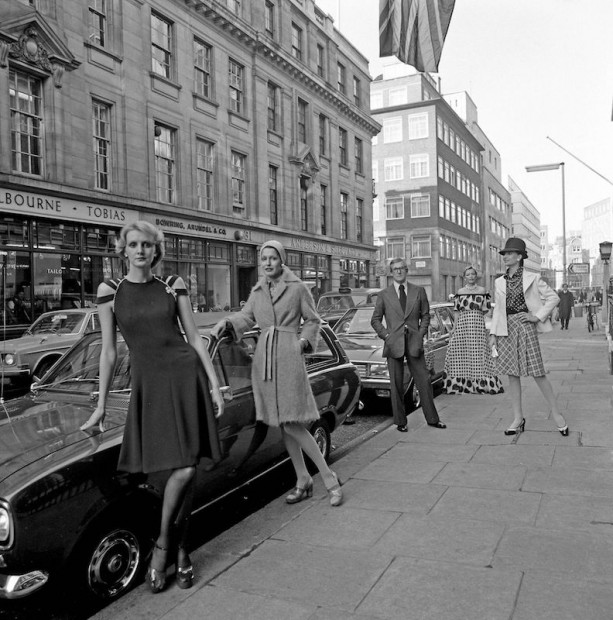 Designer for HRH Queen Elizabeth, Hardy Amies used a backdrop of Ford cars to launch his 1973 collection.