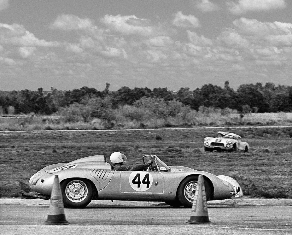 The Brumos Porsche 718 passes by the wrecked Corvette of John Fitch that flipped several times after losing a wheel.  He was uninjured.  BARC boys photo.