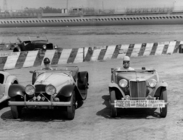 Phil Hill in his MGTC with John Von Neumann in his SS 100 Jaguar at Carrell Speedwa