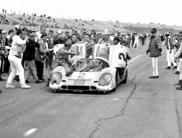 The winning Porsche 917K of Pedro Rodriguez and Leo Kinnunen coming down pit lane at the end of the 1970 24 Hours of Daytona.  Look closely and you will see Leo Kinnunen sitting on top of the car along with the mechanics.  Pedro Rodriguez was driving.