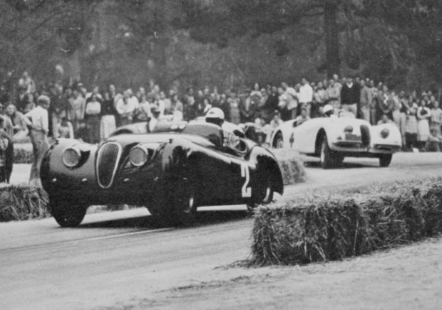 Phil Hill in his modified XK120 Jaguar on his way to winning the main event at the first Pebble Beach leading Bill Breeze in another Jaguar. (Photo: Bob Devlin Collection)