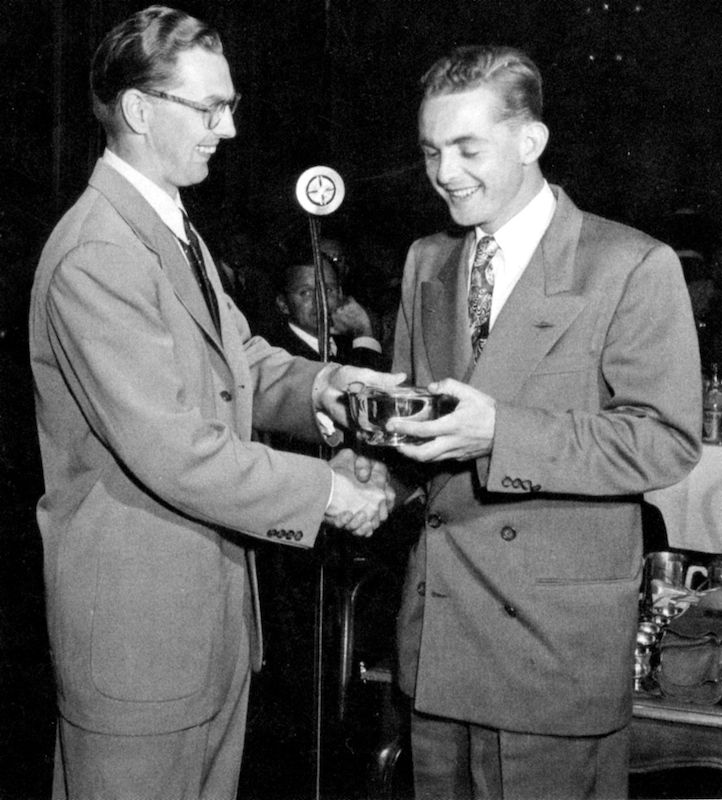 Race Chairman Kjell Qvale presenting the main-event winner's trophy to Phil Hill. (Photo: Qvale Collection)