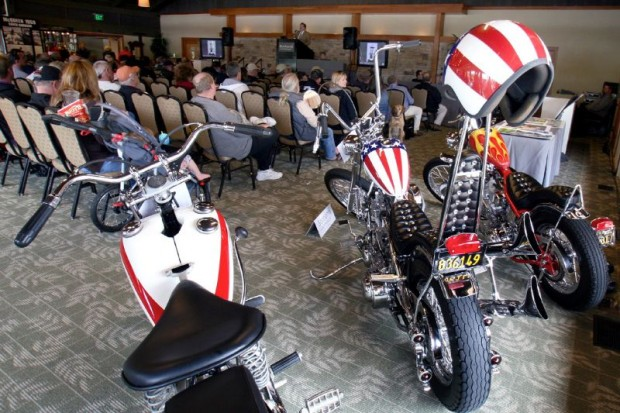 """While the far left bike did not sell, the other two did for more than anticipated.  The middle Harley chopper is a recreation 1963 """"Captain America"""" (think Peter Fonda in Easy Rider) built in 1993 for Otis Chandler that sold here for $52,650.  The other Chandler recreation (Dennis Hopper) """"Billy Bike"""" traded owners for $24,570."""