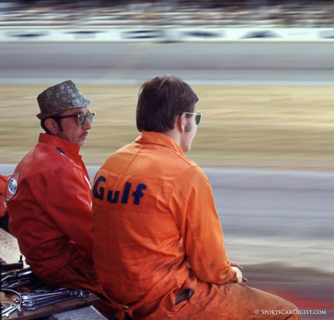 Gulf mechanics waiting for the next pit stop. The fellow with the hat is the legendary mechanic, Ermanno Cuoghi. (Lou Galanos photo)