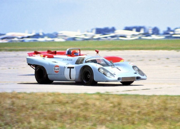 The Porsche 917K that was used as a training car for the 1970 Sebring 12-hour race.  The listed drivers for this car were Jo Siffert and Brian Redman.  This car was originally one of the top two finishers in the 1970 24 Hours of Daytona.  The photo was taken on the back airport straight of the 5.2 mile course and the car is seen passing an Alfa Romeo T33/3.