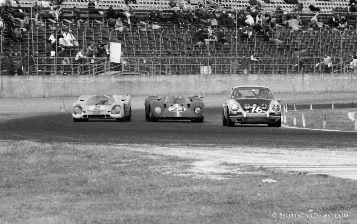 As dawn broke over the raceway Sunday morning racing was still pretty tight with a 917K Porsche, 312P Ferrari and 911S Porsche all fighting for the line through turns one and two. (Lou Galanos photo)