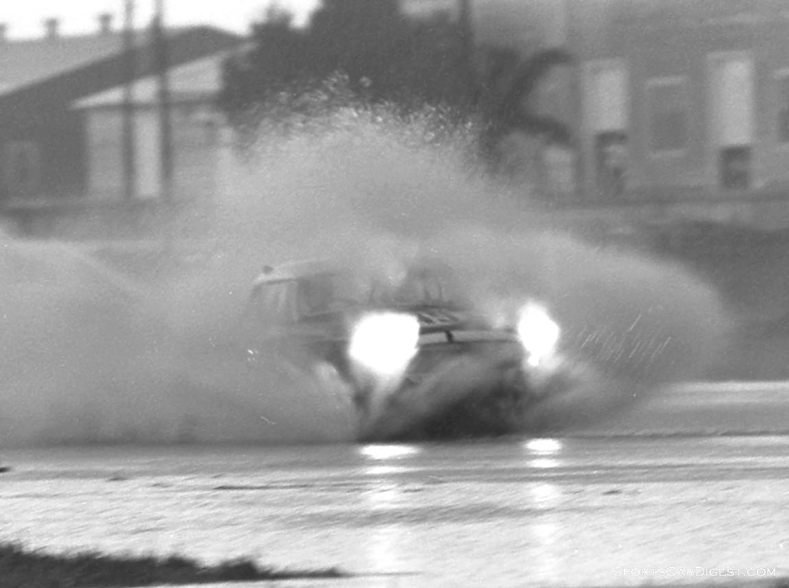 Merle Brennen and Frank Morrill took the #49 MGB to 25th overall and in this photo probably could have used scuba gear. (photo: Dave Nicholas)