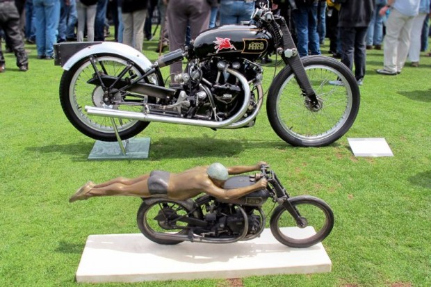 Jeff Decker's bronze reflects the famous image of Rollie Free riding the John Edgar Lightning at Bonneville 63 years ago. The bike, restored to Bonneville trim by Herb Harris, is geared to reach 100 mph in first and 150 mph in fourth.  For the Salt Flats speed runs, the alcohol-burning engine produced 108 hp. After setting the 150.313 mph record, the bike was returned to street set-up and de-tuned for owner John Edgar to run on gasoline and Benzol for pleasure rides.  Fond memories of riding this Vincent are recalled by Edgar's journalist son, William Edgar, a former owner of this history-making bike.