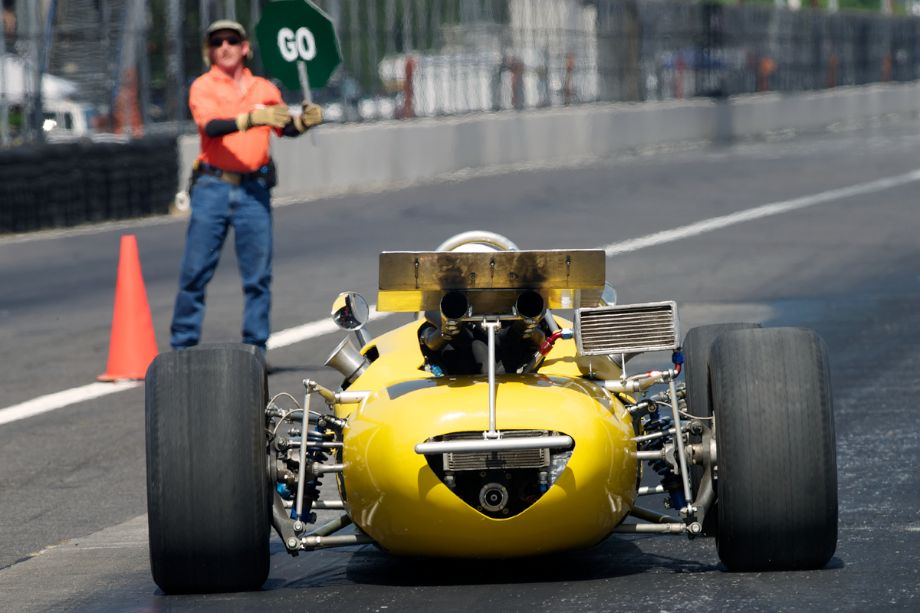 Michael McKinney accelerates the 1967 Rolla Volsted Ford Indy car out of the pits.