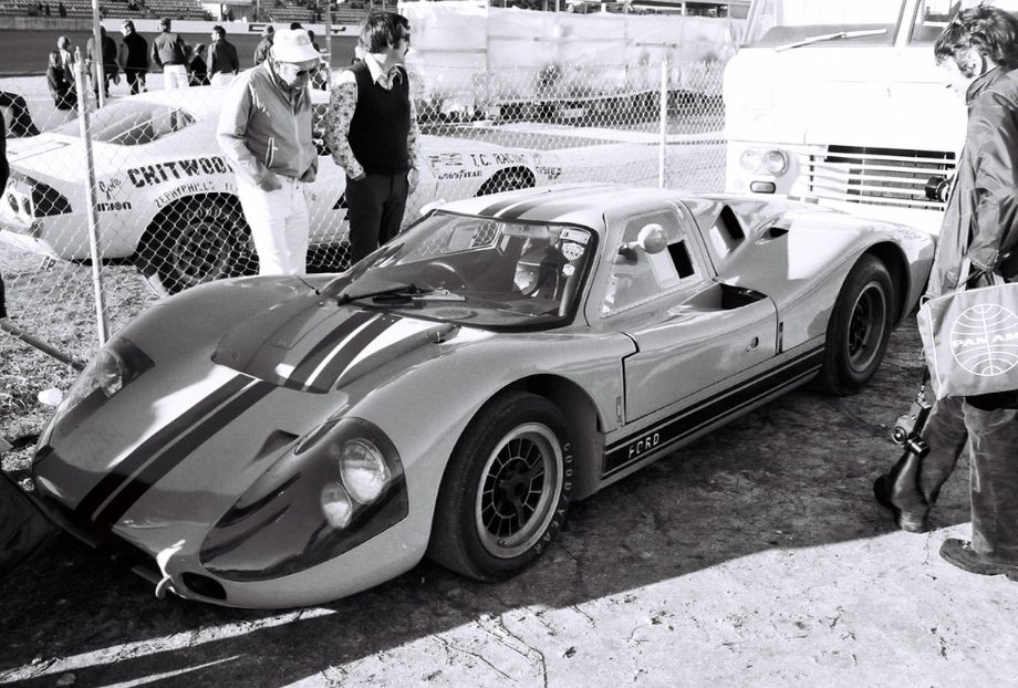 The Chitwood Racing Camaro (other side of fence) was a very early retiree, only completing six laps.  Please note however where my camera is pointed and the number of folks admiring the Ford GT40 Mark IV.  Many Daytona veterans would have loved to see a return of cars like the GT40.  Louis Galanos photo.