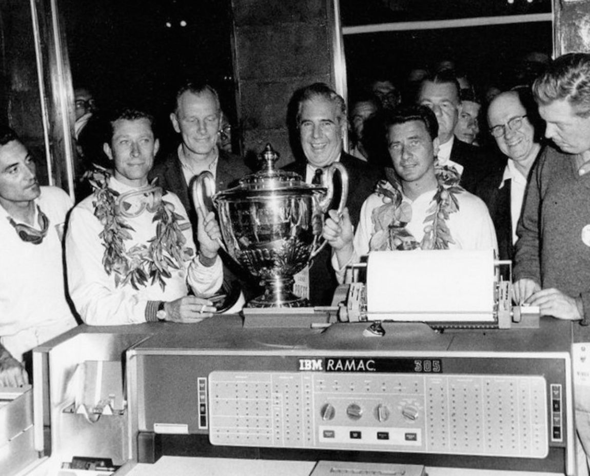 The winning team of Oliver Gendebien and Hans Herrmann posing with their first overall trophy and helping to promote the new IBM RAMAC computer.  SIR photo.