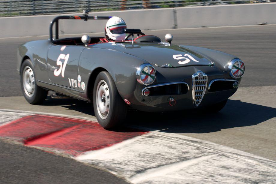 In one Mark Carpenter's 1957 Alfa Romeo Giulietta Spyder.
