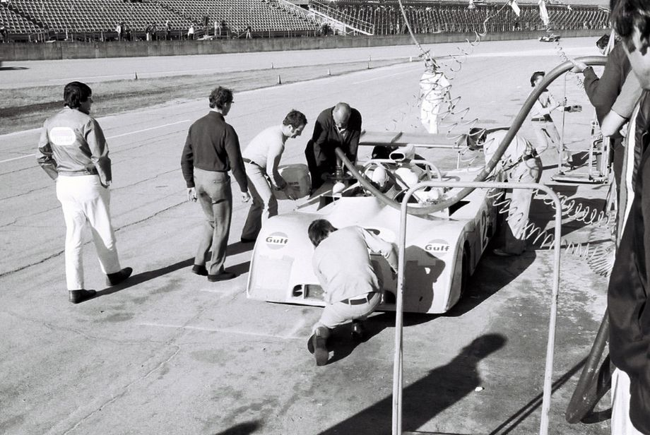 A scheduled pit stop for the Mike Hailwood - John Watson Mirage.  They too suffered from clutch problems but what sidelined them for good was a collapsed suspension suffered by Watson when he was doing 180 mph on the high banks.  Louis Galanos photo.