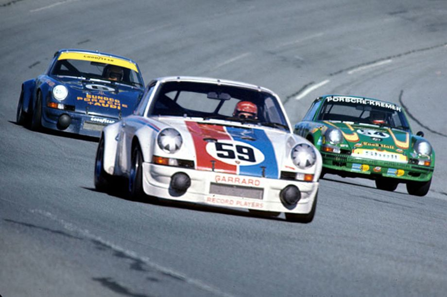 With the prototypes out or far behind the race began to focus on the Brumos and Penske 911 Carreras.  Hurley Haywood leads Mark Donohue in this photo with the Porsche 911S of Erwin Kremer in the group.  Autosports Marketing Associates, Ltd. photo.