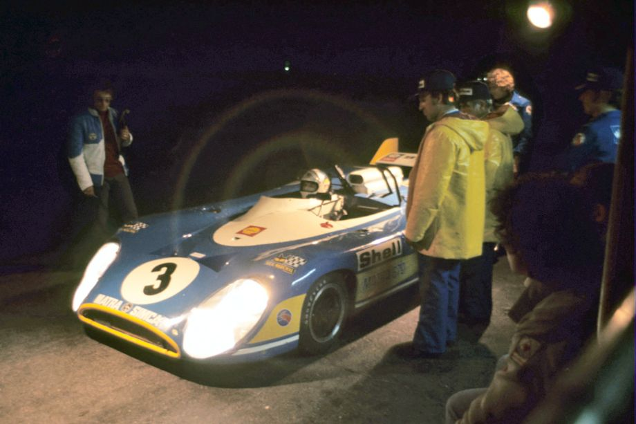 Francois Cevert waits his turn as Jean-Pierre Beltoise prepares to take the Matra out for night practice.  Fred Lewis photo.