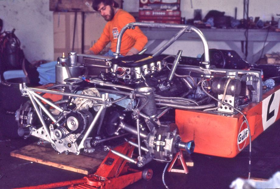 A mechanic works on the Hailwood/Watson Mirage M6 Ford.  Look closely at the right lower suspension.  It would collapse while John Watson was doing 180 mph causing a hair raising spin off the high banks and into the infield.  Richard A. Reeves photo.